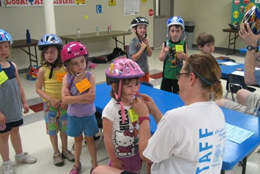 Putting on a bike helmet for safety